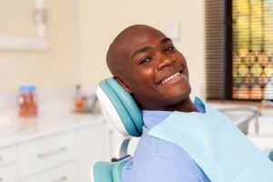Dental patient smiling in the dental chair