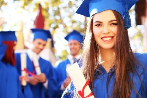woman smiling in cap and gown
