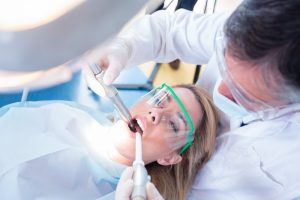 dentist in Brady treating young woman